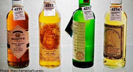Whisky auction defies finance crunch