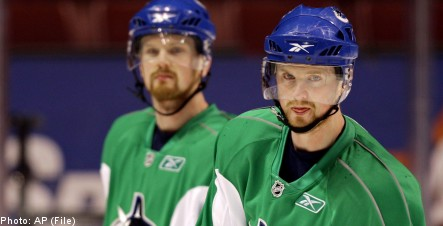 Sedin brothers ink deal to remain in Vancouver