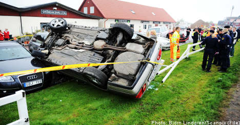 'Lynch mob atmosphere' as car somersaults onto luxury vehicles