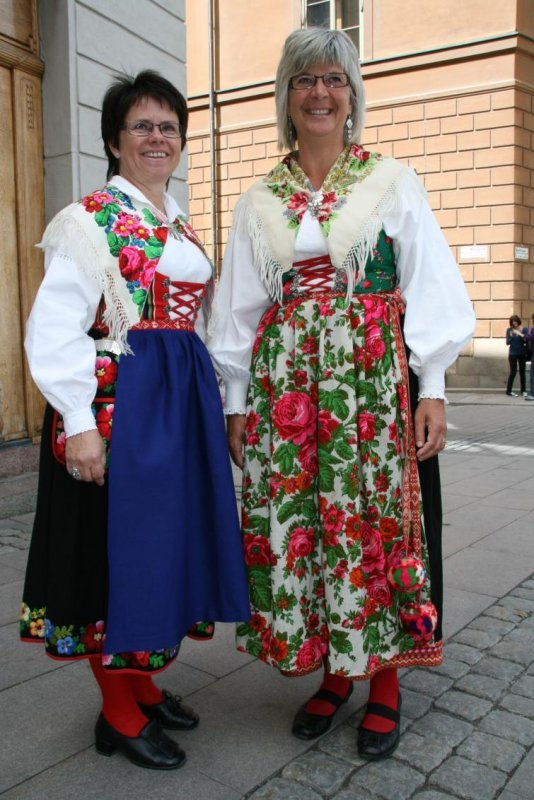 """Anna-Maria and Else-Britt, Dalarna, wearing traditional Dalarna folk costumes.<br>""""We're really excited, so we wanted to celebrate the wedding wearing our best clothes""""."""