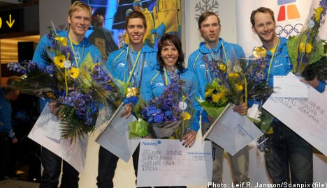 Olympic champions line up for King's medals
