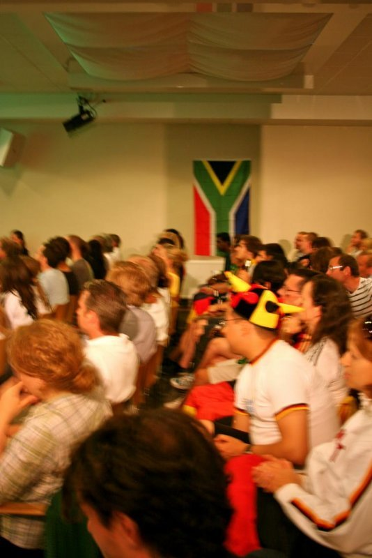 Goethe-Institut in Stockholm, Wednesday, July 7<br>A South African flag hangs on the wall as German fans proudly wear their jerseys to cheer on their teamPhoto: Emy Gelb