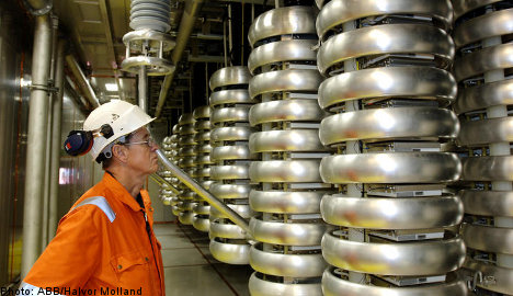 ABB Q2 earnings fall, but issues upbeat guidance