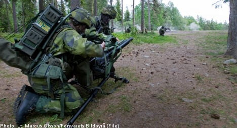Swedish soldiers wilt under load of heavy packs