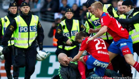 Match called off after fan attacks player on pitch