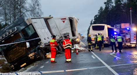 Two dead after bus collides with truck