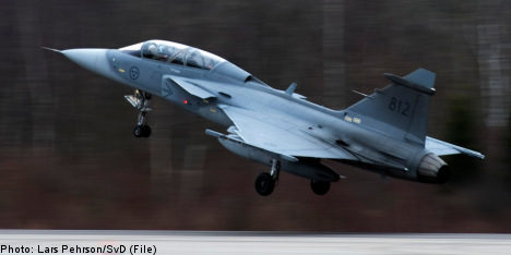 Saab to cut Swiss Gripen fighter price: report
