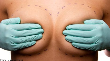 Woman's fake breasts burst after knife attack