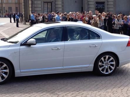 One of many white Volvos which transported royal guests to the ceremony