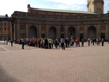 The crowd gathers outside the Royal Palace to watch guests arrive