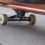 Woman dies from crash with teen skateboarder