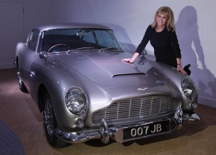 """Britt Ekland, 2012<br>Here, Ekland poses with an Aston Martin DB5 that was used in the James Bond movie """"Goldfinger"""".Photo: AP"""
