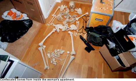 Woman charged for sex with human skeleton