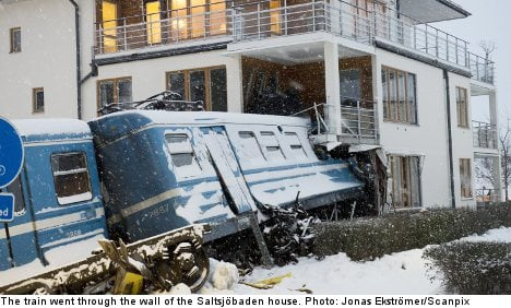 Cleaning lady steals train and crashes into house