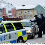 Police hold four suspects after bank heist