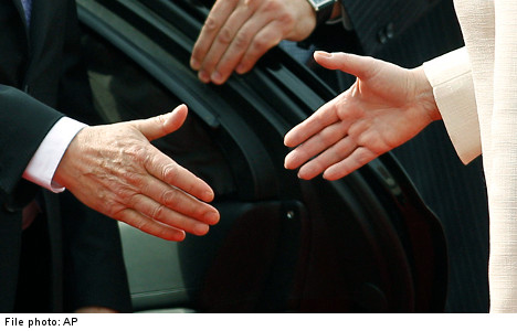 Man gets payout for not shaking woman's hand