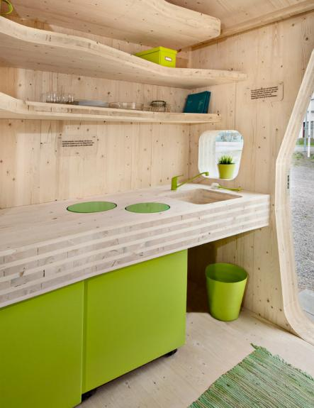 The huts even manage to squeeze in a kitchen and storage space.Photo: Bertil Hertzberg/Tengbom