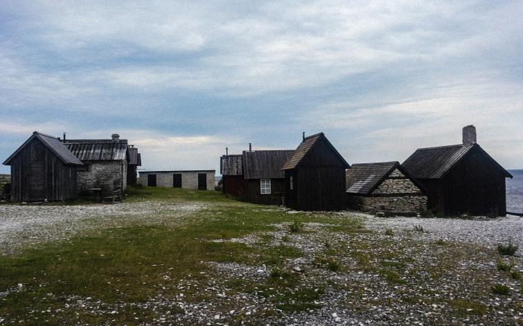 Biking around Gotland<br>Old fishing huts like these are common around Gotland. Originally used as camps for fishermen, many of them are now simply vacation homes.Photo: Joel Linde