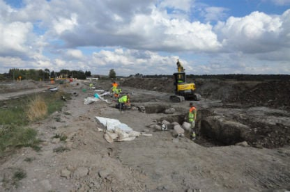 Over 140 post holes were found containing stones, pine and bones.