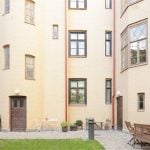A cozy courtyard below is the perfect place for chatting with neighbors or a summer picnic.Photo: Fastighetsbyrån