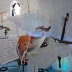 The breath of the violinists can melt their instrument, so a plastic shield is used to protect the violinPhoto: Ice Music