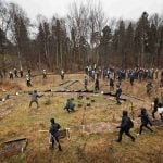 Police herd Swedish neo-Nazis into the woods near Kärrtorp, Stockholm on Sunday December 15th, 2013 after an anti-racism protest was attacked.Photo: TT