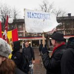Anti-racism protesters hold placards at a rally in Kärrtorp, Stockholm on Sunday December 15th, 2013. Photo: TT