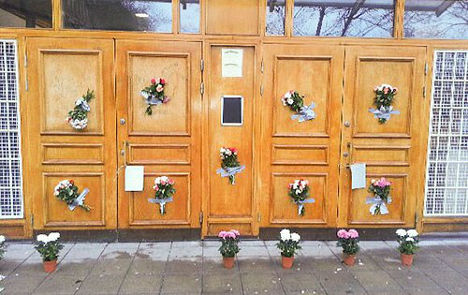 Flowers cover swastikas after mosque attack