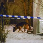 Police hunt suspects in gangster killing