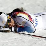 Sweden's Charlotte Kalla lies on the snow after winning her second silver medal.Photo: AP