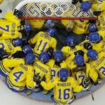 Team Sweden gathers around the net before playing the USA in the 2014 Winter Olympics women's semifinal ice hockey. They went on to lose 6-1.Photo: AP