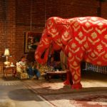Tai, an Indian female elephant stands in the middle of a couple's home in a performance art piece by Banksy. Photo: Damian Dovarganes/AP