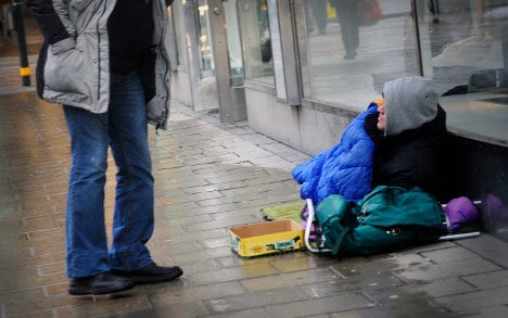 Woman charged after accusing beggar of theft