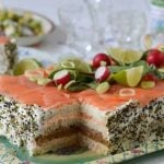 """<b>Smörgåstårta</b>. """"It tastes nice but sits badly in the stomach,"""" says @jamespage79 on Twitter. """"Savoury food shouldn't be cake."""" The layered cake features bread, cream, and toppings included (but not limited to) liver pâté, shrimp, tomato, lemon, salmon and olives. It is usually served after being chilled in the fridge overnight.Photo: Leif Jansson/TT"""