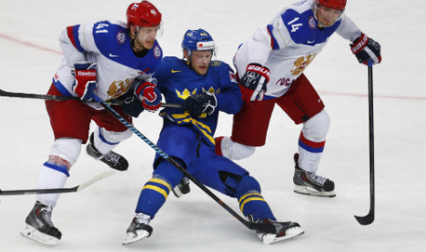Swedes fall as Russia books hockey finals berth