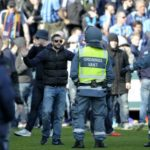 Football fans held for violence and Nazi chants