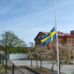 The Swedish flag flies at half mast at the girl's school, where she was in the second grade.Photo: TT