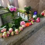 Flowers and candles amass outside the girl's home.Photo: TT