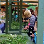 Swedes line up to make Midsummer wreathes.Photo: The Local/Solveig Rundquist