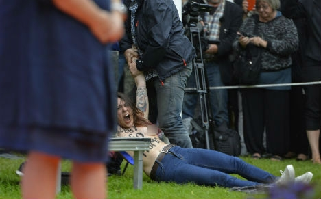 Topless protesters fined after Reinfeldt demo