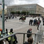 Swedes throw stinky fish at calm neo-Nazi rally