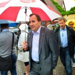 The election campaign really got underway at Almedalen, a week-long political event on the Swedish island of Gotland. Here we see Social Democrat head Stefan Löfven braving the summer rain on the way to giving a speech. Photo: TT