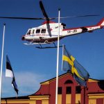 A rescue helicopter flying over the Estlines headquarters in Stockholm on the day of the disaster. The Swedish flag is flying at half mast as a mark of respect. Photo: Anders Wiklund /TT