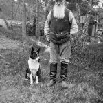 The farmer Carl Persson, 69 years old, with a dog. This photo was taken in Gustavsberg.