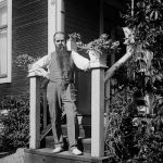 The photographer himself, Einar Erici, on the doorsteps of a house. We don't know where this is or who took the photo but we've glad they did.