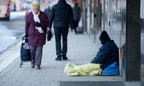 Shop manager fined for dousing beggar