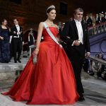 Crown Princess Victoria in a traditional red ball gown and Nobel Chemistry Prize laureate Eric Betzig arrive at the Nobel Banquet in Stockholm City Hall on Wednesday.Photo: Claudio Bresciani/TT