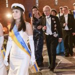 King Carl XVI Gustaf and chemistry laureate May-Britt Moser followed by Queen Silvia and Carl Henrik Heldin as they leave the Blue Hall for the Nobel Banquet at Stockholm's City Hall on Wednesday.Photo: Fredrik Sandberg/TT