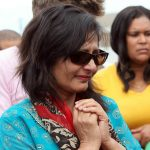 While Anni's mother Nilam Hindocha fights back the tears at the murder scene. Photo: AP Photo/TT