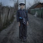 1st place, Portrait. A Moldovian youth plays cop in a police costume given to him by an English missionary.Photo: Åsa Sjöström (Kontinent)/Årets Bild